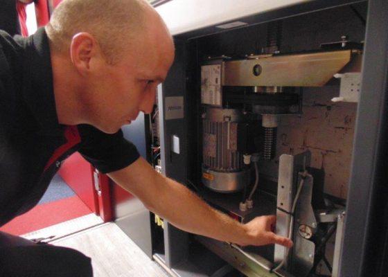 Gartec Service Engineer Examining Platform Lift