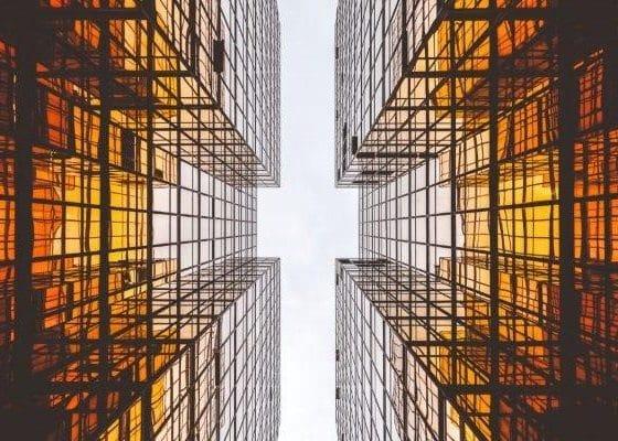 Looking Up Between Glass Buildings